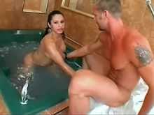 Gorgeous shemale deep throats huge cock in jacuzzi