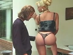 Nice guy serves mistress shemale in leather dress